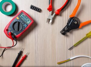 Collection of tools available at the electrical wholesaler - Pliers, Cable, Cable strippers, Multi meter and insulating tape